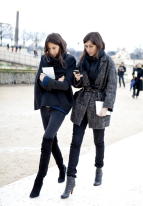 French fashion editors. classy in black. always in style. love the belted oversize coat on Emmanuelle Alt.